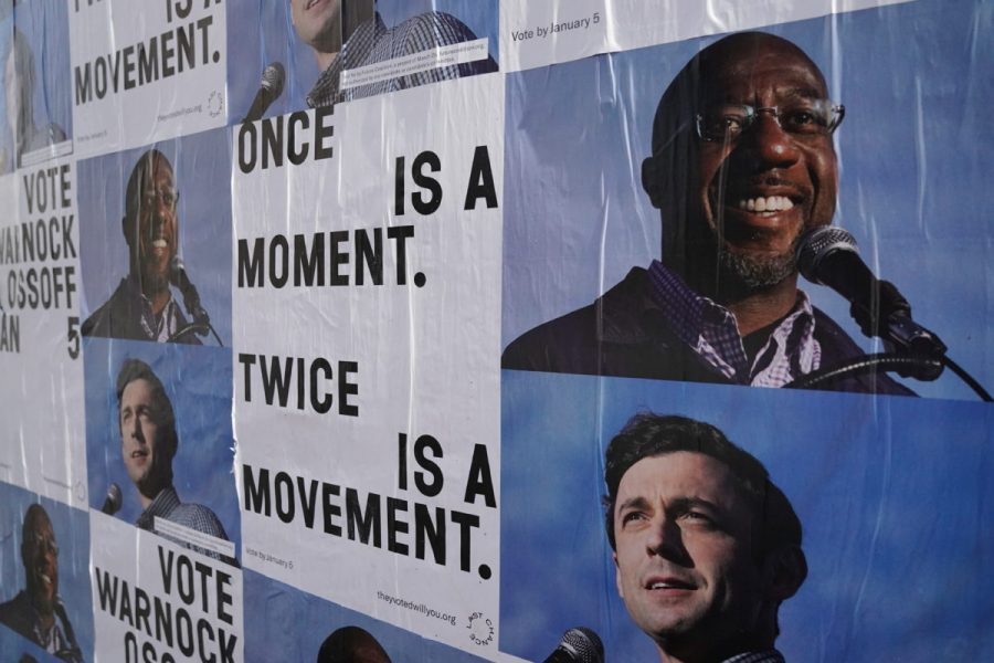 Campaign ads for Jon Ossoff and Raphael Warnock are seen on a wall  near the John Lewis mural the day after the U.S. Senate runoff elections in Atlanta, Georgia, U.S., January 6, 2021.  REUTERS/Elijah Nouvelage